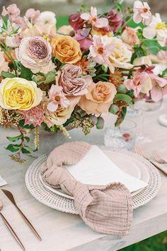 Burgundy, yellow, blush, and burnt orange floral centerpieces. Photo: @lucystruve Floral Centerpieces, Burnt Orange, Garden Wedding, Floral Wreath, Burgundy, Blush, Table Decorations, Yellow, Chic