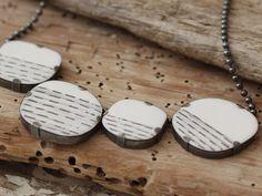 Silver, enamel, graphite neckpiece by Rachel Brown