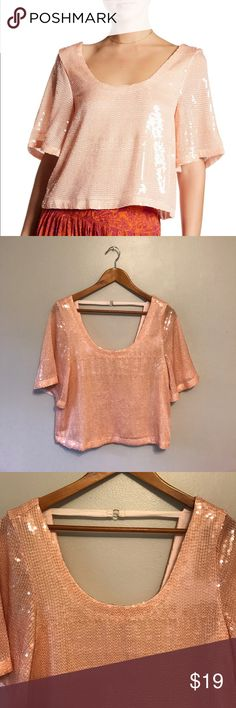 "Free People Night Fever sequin tee in pink blush Fabulous Free People ""Night Fever"" top.  This size extra small piece measures approximately 17.5"" armpit to armpit laid flat and 20"" in length.  In good used condition, it does have some visible sequin seamlines at the bust and right sleeve (see photos) and a few misaligned sequins and threads at the bottom hem (see photo), but in otherwise good condition.  Cover photo from Free People website. Free People Tops"