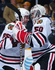 NASHVILLE, TN - FEBRUARY 10: Andrew Shaw #65 congratulates Corey Crawford #50 of the Chicago Blackhawks for his shutout against the Nashville Predators during an NHL game at the Bridgestone Arena on February 10, 2013 in Nashville, Tennessee. (Photo by John Russell/NHLI via Getty Images)