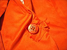 Detail of jacket and button.