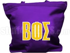 Purple Beta Phi Sigma tote bag with the Greek letters across the front. Letters and designs are sewn on.