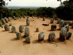 Almendres Cromlech, Alentejo - PORTUGAL. Boasting a spectacular hillside location among olive and cork trees, this stone circle is an important megalithic site, consisting of 96 standing stones arranged in an oval. Architects: unknown. Style: Megalithic. Material: Granite. Construction Initiated: 6000 BCE.