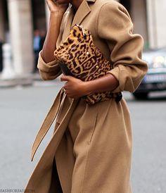 beige coat and an animal print bag