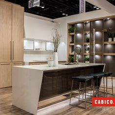Contemporary display with sliding glass doors \u0026 white oak cabinetry. Unique Series by Cabico & Electric powered doors go up and out of the way and close with the ... Pezcame.Com