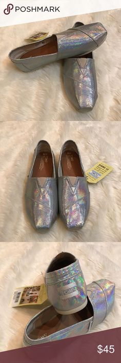 NWT Toms Women's Classic in Silver Shine Size 10 NWT Toms Women's Classic in Silver Shine Size 10. Shoes are new with tags. Amazing iridescent Silver toms. Hard to find version of this classic shoe! Toms Shoes
