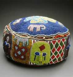 Africa | Royal foot cushion from the Yoruba people of Nigeria | Leather, cloth, beads and natural fiber