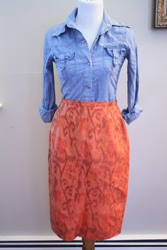 Ikat print orange 80's silk skirt. $30.00, via Etsy. great vintage at this shop!