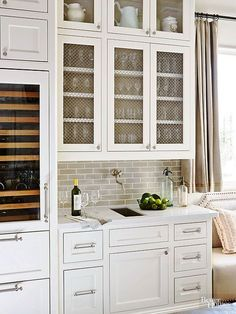 A wet bar, no matter how small, is essential for gathering stemware, beverages, and cocktail fixings in a central location without disrupting the work triangle. Consider a built-in, temperature-controlled fridge to keep wine perfectly chilled, as well as a separate sink.