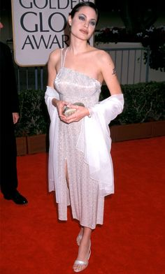 Angelina Jolie, 1998 from Stars' First Golden Globes  16 years later and it's safe to say, Angie still totally owns the goth vibe. And to think it all started when she won Best Actress for the TV movie George Wallace. We gotta say,the star's over-the-top makeup is almost more eyecatching than her dress!