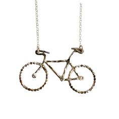 Bike Necklace - Score yourself some shiny new wheels. This handmade, recycled sterling silver bike sits on a 16-inch sterling silver cable chain. The pendant features a stunning hammered and polished finish that gives this piece a sleek look. This charming necklace proclaims your love for vehicles of the two-wheel variety, and is guaranteed to catch eyes as you cruise on by.