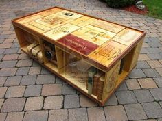 Very Cool coffee table made out of wine crates :)
