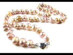 Pearl knotting tutorial showing you how to knot pearls onto silk thread using french wire and a clasp