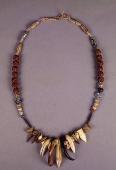 Native American (Ute) six string bead necklace made from seeds and juniper berries strung on black cotton thread.   Ute Indians--Arts & crafts--1860-1870