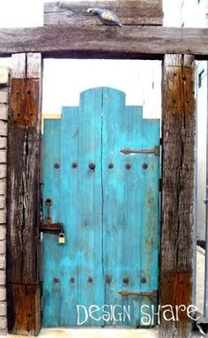 Gate in classic Southwest turquoise...love the frame and rustic hardware