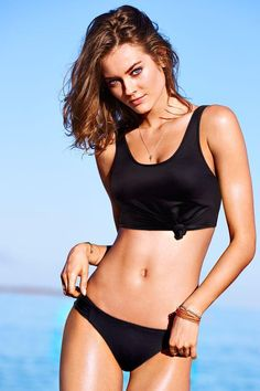 21d87a18d9f The tank spills over from street to sand in this effortlessly cool bikini  top. /