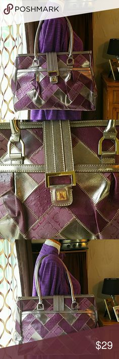 "LIZ CLAIBORNE *nwot* Purple & Metallic Silver Tote Brand: Liz Claiborne  Item: *Metallic Silver Faux Leather, Faux Purple Textured Leather & Purple Canvas Patchwork Tote, Shoulder Bag *Exterior Features one Full Length Pocket On Each Side *Large Zippered Compartment Divider in Interior *2 Pockets & 1 Zippered Compartment in Interior *Silver Ovee the Top Snap Closure  Color: Purple, Silver  Measurements:15""w x 12""h 3.5""d, 8"" Drop.  Condition: New Without Tags NWOT Liz Claiborne Bags Shoulder…"