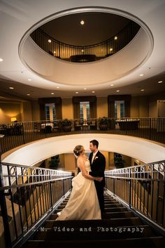 Bride and Groom on the staircase in the Glen Club. www.remvp.com