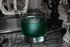 Lesser Demon 1 oz spiced rum (Captain Morgan)  1 oz Southern Comfort  3/4 oz blue curaçao (It's what I have on hand. You may use orange curaçao.)  3/4 oz sour mix  1/2 oz Midori  ice  Add all the ingredients to a shaker with ice. Stir gently. Strain into a rocks glass with ice. I used a large ice globe for this to better control the melt. Use cubes if you like to weaken your drink. I didn't garnish this (I rarely do) but I think a few orange twists would be great with this drink.