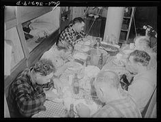 On board a fishing vessel out from Gloucester, Massachusetts. Crew eating in the forecastle. The one room serves as dining room, bedroom and kitchen. Between times the men use it for a game room, where they play cards and discuss politics Photographer Howard Liberman Created September 1942