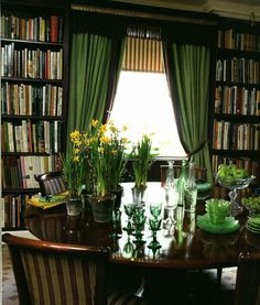 Stylish green London dining room and library by Nina Campbell.