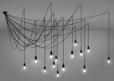 A tentacular ceiling lamp, a lighting mesh with endless combinations. Ceiling lamp with 14 bulbs Design: Selab Material: Silicon, plastic, metal Cables: 14 x 4 mt . Ceiling Pendant, Pendant Lamp, Pendant Lighting, Ceiling Rose, Led Ceiling, High Ceiling Lighting, How To Make A Chandelier, Applique, Modern Ceiling