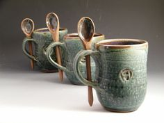 Handmade stoneware mug, with built in spoon rest. Never be without your tool for playing in your marshmallows.