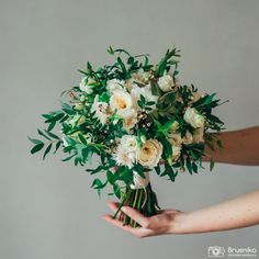 Tender bridal bouquet of eustoma, eucaliptus, pistachio, echeveria, cornflower, David Austin rose, wax flowers