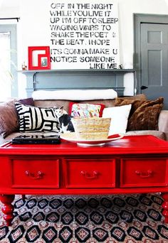 I love the red coffee table!