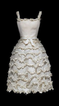 "VOGUE FASHION WORLD. NEWS&TRENDS. CELEBRATE&PARTY STYLE. FALL -15….AFTER SUMMER WORLD FASHION.1954 ""Muguet"" Lily of the Valley Dress by Christian Dior"