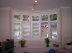 1930's Bay Window Shutters Installed Using 5 Frames
