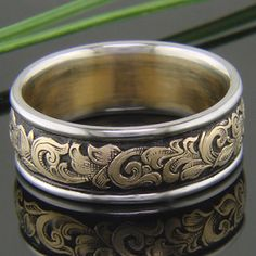 Antiqued western engraving on 14k yellow gold with white gold rails