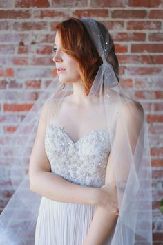 cap veil, photo by Tina Chiou Photography http://ruffledblog.com/wedding-inspiration-with-magnolia-leaves-and-cotton #weddingfashion #veils #brides
