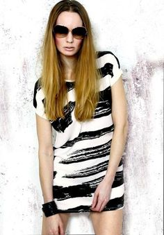 With it's black statement stripes the Ayita Mini Shift Dress/Top is a versatile piece for...