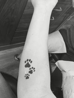 Commemorative dog paw tattoos