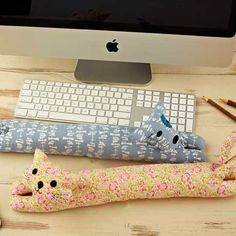 Padrão do desktop animais de descanso de pulso de costura