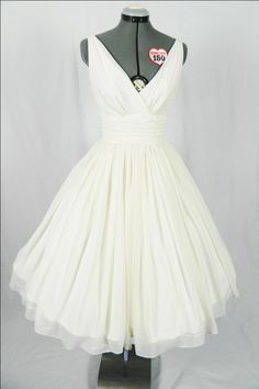 Simple and elegant 50s style dress. Ivory chiffon overlay, flattering for all sizes. $265.00, via Etsy.