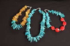 Natural stones of raw amber, turquoise, and rd coral.