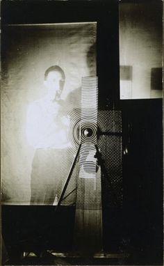 Marcel Duchamp with one of his Rotary Glass Plate  Machine Paintings (in motion)