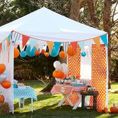 Forget haunting ghouls and spooky ghosts -- fun is in the air at this backyard Halloween party. We've blended the best parts of country fairs, carnivals, and circuses to show a lighter, brighter side of Halloween at this fall party for kids.