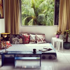Beautiful printed cushions well arranged on low seating, perfect reading space !!