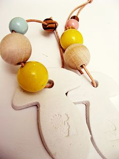 christmas ornaments: great idea to make these with your kids. Paper clay+cookie cutters+leather cord+plastic and wooden beads.