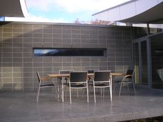 Honed coloured concrete patio by Michael Wyatt Architect, Queenstown
