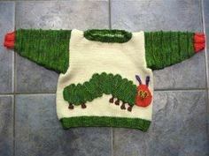 Hungry Caterpillar Jumper by RooKnits.  Raverly pictures.  This does not appear to be a pattern, rather a plain crew neck boy's pattern with the colorful addtions of the arms, wrists and neck.  Then, add the embellishment of the worm.  Very clever!!!!