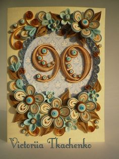 Quilled card for anniversary in blue and brown colors.