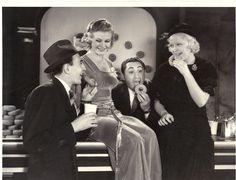 Richy Craig, Jr., Ginger Rogers, Benny Rubin, and Mary Carlisle attend the 19th annual benefit for the Los Angeles Examiner's Christmas Dinner Fund at the Shrine Civic Auditorium Dec 16, 1932