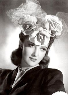 Martha Vickers wearing a really beautiful hat.