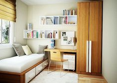 small bedroom ideas for young women with single white bedroom next to windows and small workspace with floating build in bookshelves in white and wooden cupboard