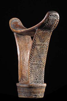 Carved hardwood headrest from Somalia.