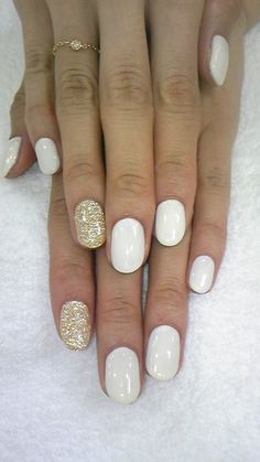 Classic white and gold nails>>I like that--hint of gold. Nice